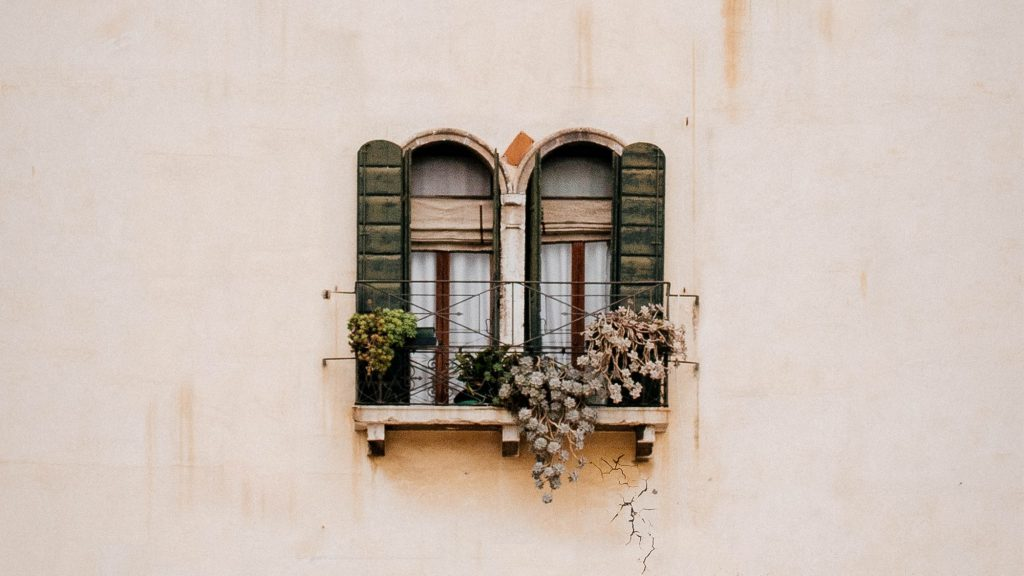 green-wooden-window-on-white-concrete-wall-small